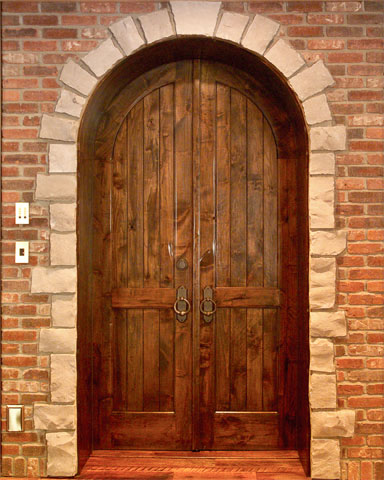 plank panel door with true arch