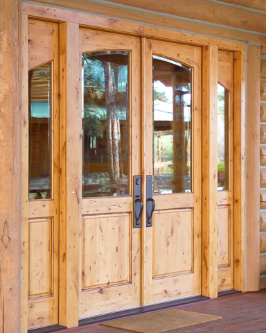 Knotty pine entry door with sidelights
